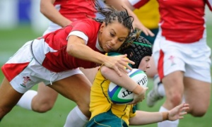 Wales full-back Non Evans, who is taking part in wrestling at the coming Commonwealth Games, tries to tackle Nicole Beck. Photograph: Tom Jenkins