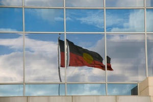 Aboriginal flag reflected in building window